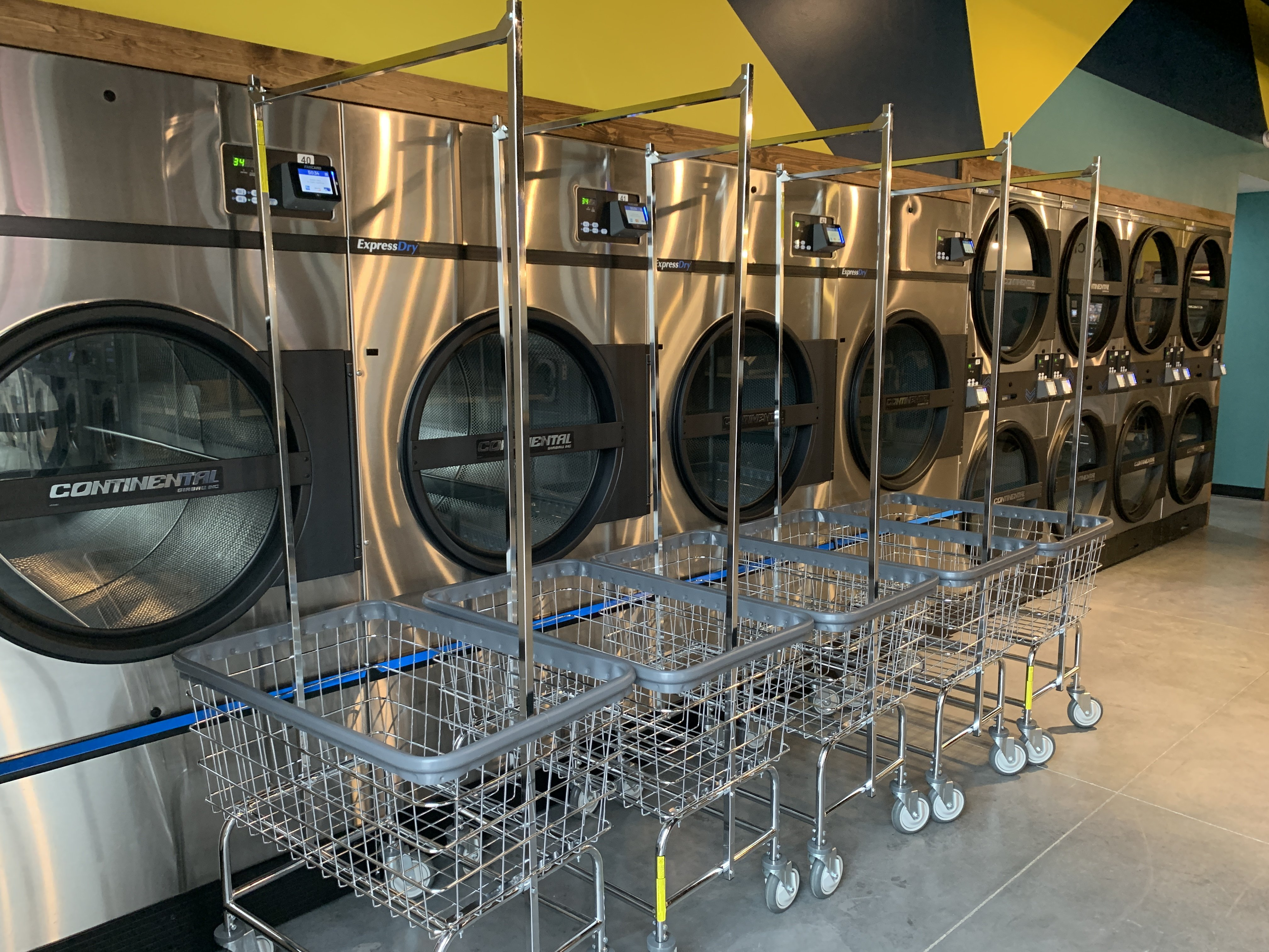 Continental Girbau 75 pound and 90 pound stack commercial dryers